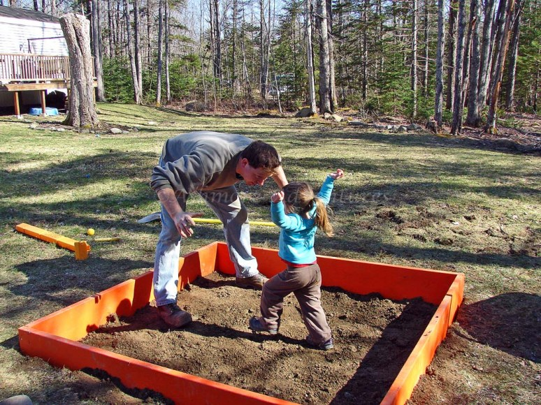 4/22/13 Briefly considered filling it with water and making a toddler mud wrestling pit instead. Decided that a sand box is going to be messy enough.