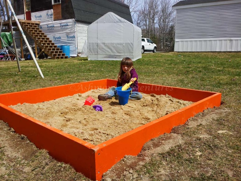 4/23/13 Playing in her new sand box.