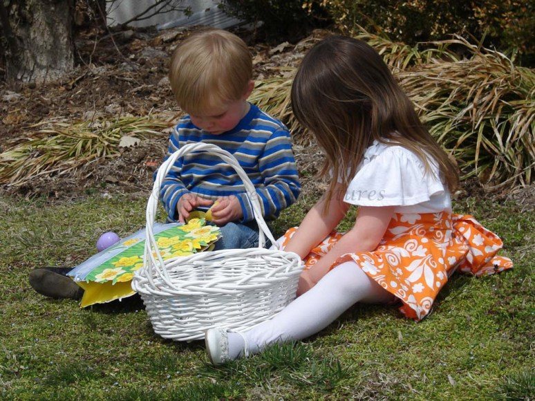 3/30/13 Cousins taking tally of their loot (I think they collected 5-6 eggs between them).