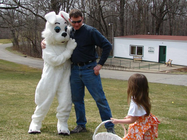 3/30/13 She insisted that Artie hug the Easter bunny, but it looks like she's ready to bolt if necessary.