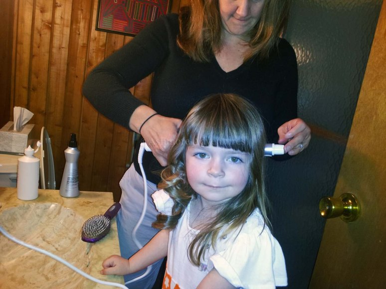 3/30/13 Having her hair curled for the first time.