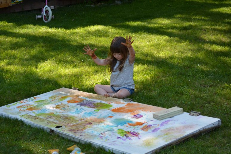 6/9/13 A little outdoor finger painting, starts out so....orderly...