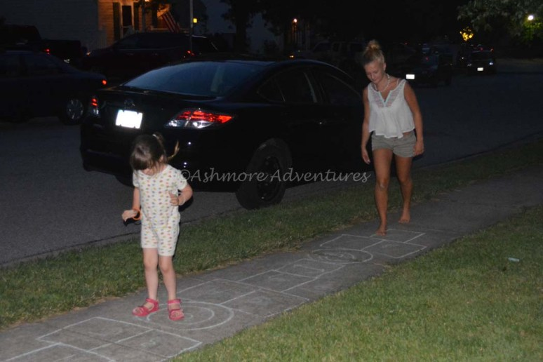 6/28/14 Learning some new Hopscotch moves from cousin Sarah.