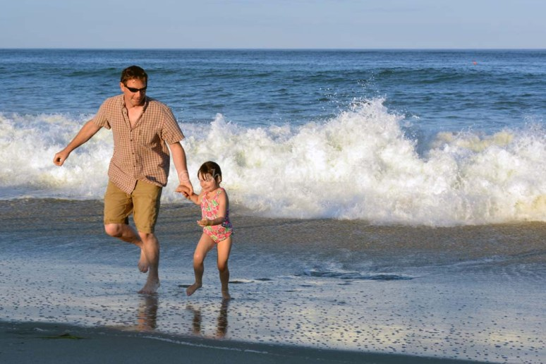 8/28/14 Running from the waves at Nauset Beach, Cape Cod.